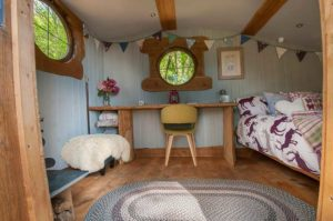 inside glamping shepherds hut nyth robin