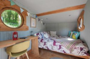 bedroom in glamping shepherds hut aberdyfi